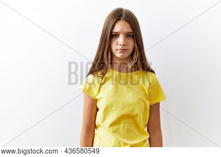 Young brunette teenager standing together over isolated background skeptic and nervous, frowning upset because of problem. negative person.