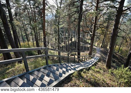 Wooden Staircase With A Railing Made For Climbing The Hill In The City Park