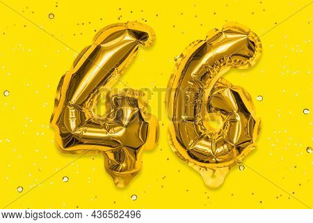The Number Of The Balloon Made Of Golden Foil, The Number Forty-six On A Yellow Background With Sequ