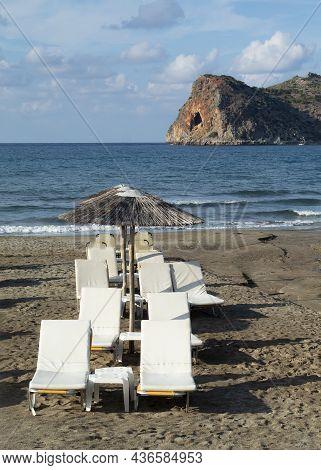 Agia Marina, Chania Crete  Beautiful Greek Beach Scene  Sun Loungers On The Sands Vertical Shot With