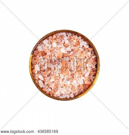Top View Of Pink Himalaya Salt Seasoning In Round Brown Wooden Bowl Isolated On White Background.