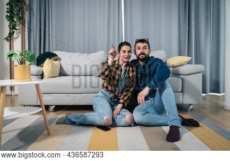 Couple Watch Television Show And Man Fake That He Is Interested While Woman Explaining To Him Who Is