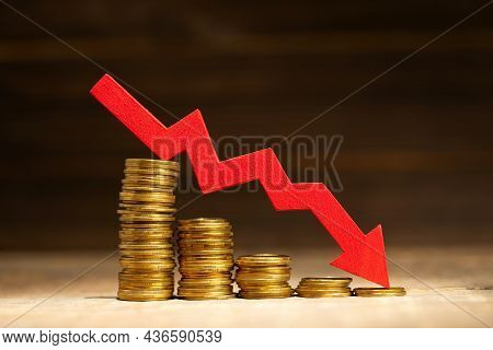 Red Down Arrow. Stack Of Gold Coins, Steps Down. Money Loss Concept