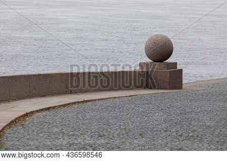 Granite Ball On The Spit Of Vasilyevsky Island. Saint Petersburg, Russia.