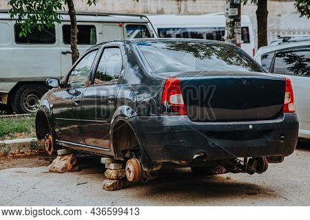 Zaporozhye, Ukraine - July 14 2020 : A Broken Passenger Car Without Wheels Stands On Bricks