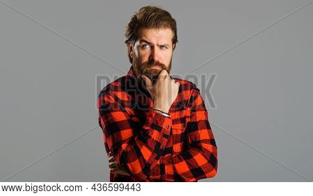Pensive Bearded Man In Plaid Shirt. Thoughtful Handsome Male. Solution Of Problem.