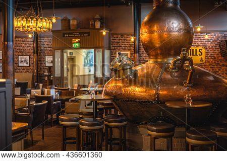 Bushmills, Northern Ireland, Aug 2019 Large, Copper Fermentation Vat In Bushmills Whiskey Bar As Dec