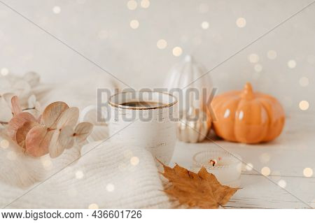 Details Of Still Life, Cup Of Tea Or Coffee, Pumpkins, Candle, Brunch With Leaves On White Table Bac