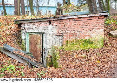 Entrance To An Old Ruined, Weathered And Abandoned Underground Bunker