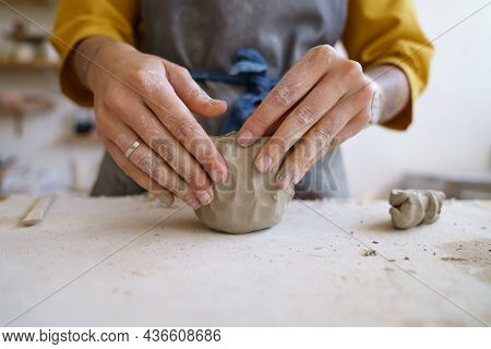 Work With Your Hands: Closeup Of Creative Woman Molding Raw Clay Before Sculpturing And Shaping Pott