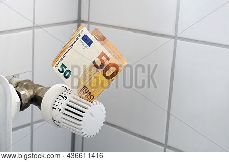 Euro Banknote Stuck In The Thermostat Of An Heating Radiator, Rising Costs For Heat And Energy, Home