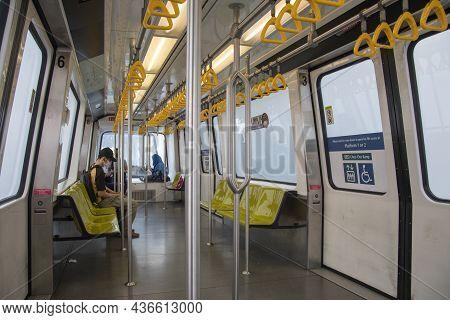 Singapore- 16 Oct, 2021: Passengers Travel With Light Rail Transit (lrt) Train In Singapore. Bukit P