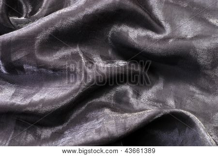 Black Folded Shiny Organza Background.
