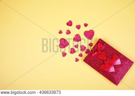 Happy Valentines Day Flatlay. Top View Present Gift Box, Hearts, Glasses On On Yellow Color Of The Y