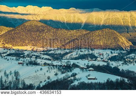 Amazing Winter Morning Landscape With Picturesque Snowy Mountains. Beautiful Sunrise And Snowy Mount
