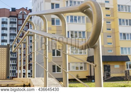 Stairway With Metallic Banister In A New Modern Building. Railing At The Entrance To An Apartment Bu