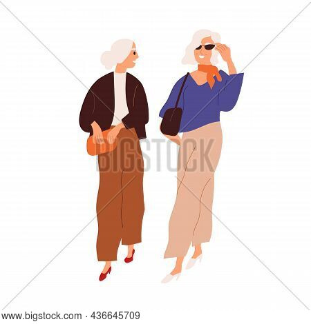 Modern Senior Women Friends Walking And Talking Together. Fashion Elegant Elderly Gray-haired Ladies