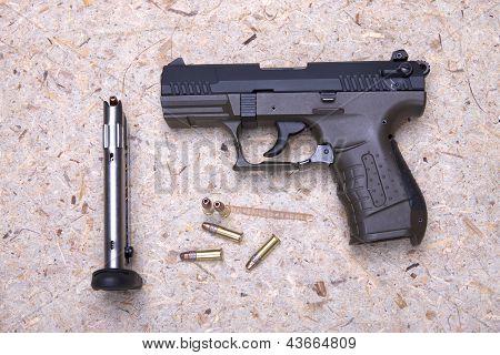 Handgun And Bullets.