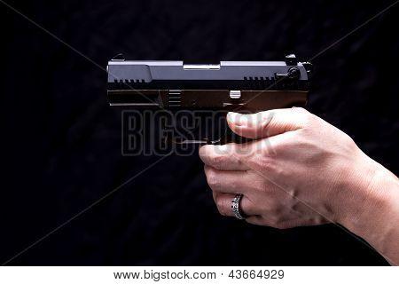 Aiming A Pistol.