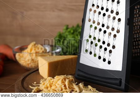 Grater And Delicious Cheese On Wooden Board, Closeup