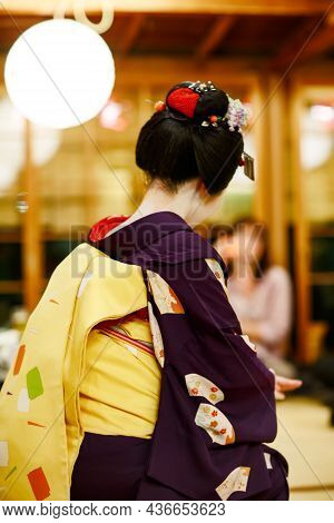 Maiko Apprentice Showing Japanese Traditional Dance. Maiko Is An Apprentice Geisha. Maikos Performin