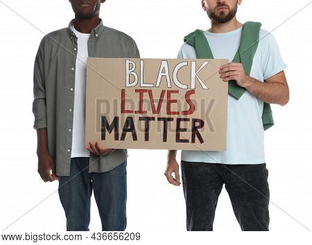 Men Holding Sign With Phrase Black Lives Matter On White Background, Closeup. Racism Concept