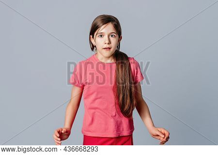 Portrait Of Impressed And Intrigued Attractive Emotive Young Girl Gazing At Camera, Being Curious, W