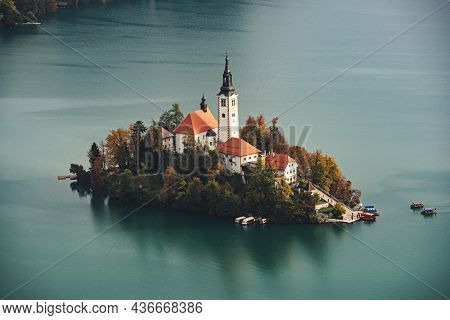 View To The Church Of Assumption In Lake Bled, Slovenia In The Autumn With Colorful Trees