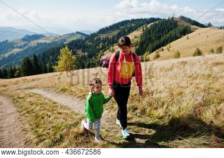 Mother And Daughter Hiking In The Mountains.the Concept Of Family Travel, Adventure, And Tourism. Li