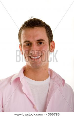 Casual Young Man In Pink Shirt Smiling