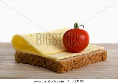 Bread Slice With Cheese Cherry Tomato On Wooden Board