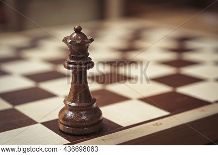 Close-up Of A Chess Piece On A Wooden Chessboard