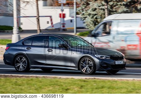 Moscow; Russia - October 14; 2021: Black Bmw Series 5  Is Driving Fast On The Street On A Warm Autum