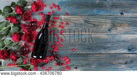 Valentines Day Holiday Background With A Bottle Of Wine, Drinking Glasses, Red Roses, Corkscrew Open