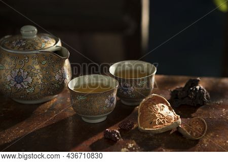 Close Up View Of Nice China Teapot And Glasses On Color Back