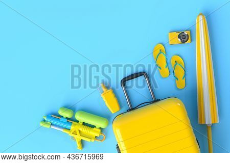 Colorful Suitcase Or Baggage With Beach Accessories On Blue Background.