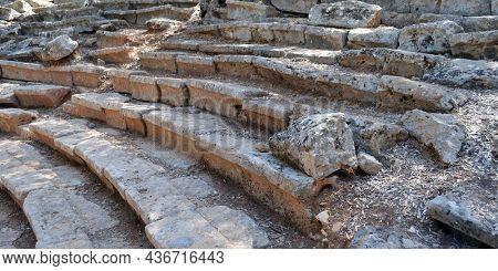Ruins of the antcient greek theater in Kedrai city ruins. August 1,2021. Sedir island,Gulf of Gokova, Aegean Sea, Turkey