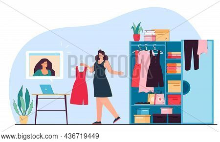 Woman Getting Clothes From Wardrobe And Choosing Outfit In Front Of Computer Using Online Recommenda