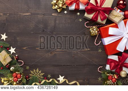 Christmas Holiday Background. Christmas Ornaments And Gift Boxes On Wooden Background Top View. Chri