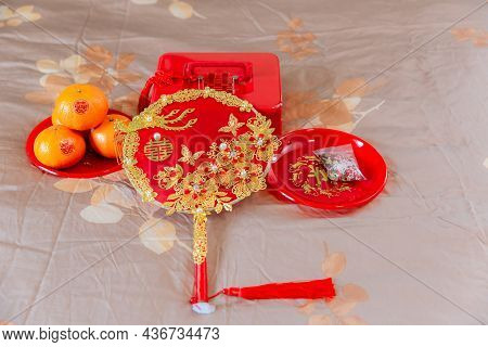 Accessories In A Chinese Wedding. A Fan For The Bride At A Wedding Is Object That Represents Good Me