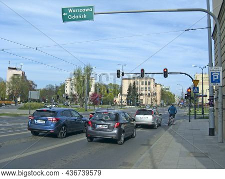 Lodz - Poland. 18 June 2019: Cars On Busy City Street. Queue Of Cars In Two Rows At Crossroad. City