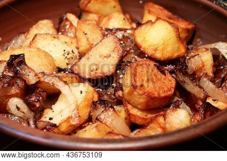 Potatoes With Onion On Clay Plate.closeup View.roasted Baby Potatoes.fried Crispy Potatoes. Cooking