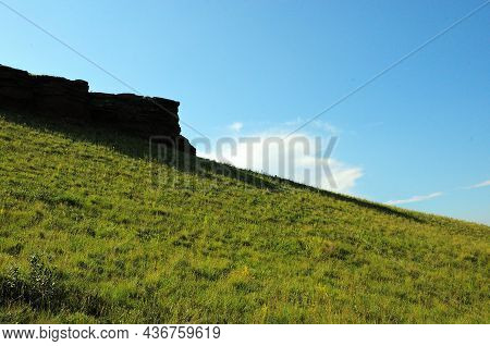 Remains Of An Ancient Fortress Wall On The Slope Of A High Hill Overlooking A Picturesque Valley On
