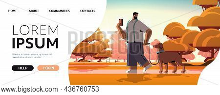 Young Man Walking With Dog In Urban Park Male Owner And Cute Domestic Animal Friendship With Pet Con