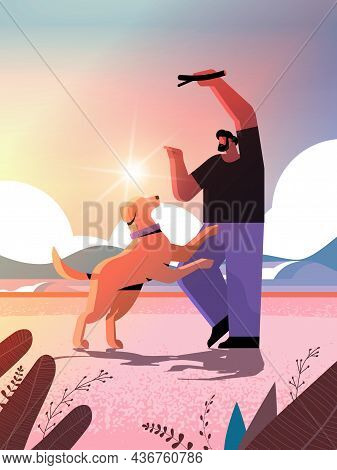 Young Man Spending Time With Dog Male Owner And Cute Domestic Animal Having Fun Friendship With Pet