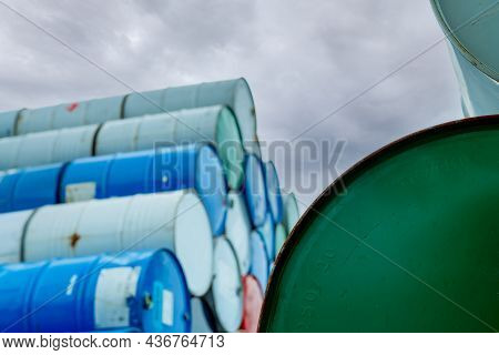 Selective Focus On Green Old Chemical Barrels Stack. Steel Tank Of Flammable Liquid. Hazard Chemical