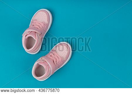 Pink Child Shoes On Blue Background. Children's Shoes For Girls