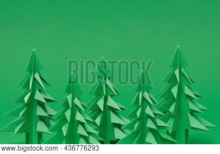 Christmas Trees Paper Artwork In Green Background. Christmas Tree Paper Cutting Design Card. Diy 3d