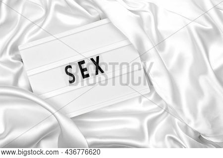 Sex Or Sexuality Abstract Concept Without People, Word On Lightbox Or Light Box Sign On White Fabric