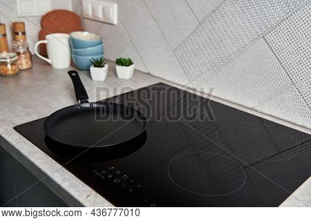 Modern Kitchen Appliance. Cooking Pan On The Surface Of Induction Panel With Sensor Panel